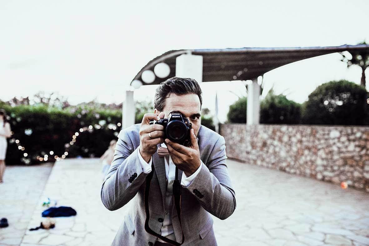 wedding photographers mallorca groom camera