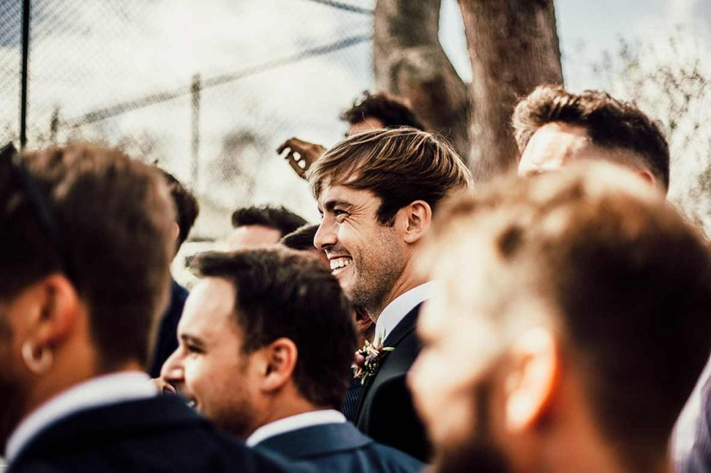 natural wedding photographer groom happy